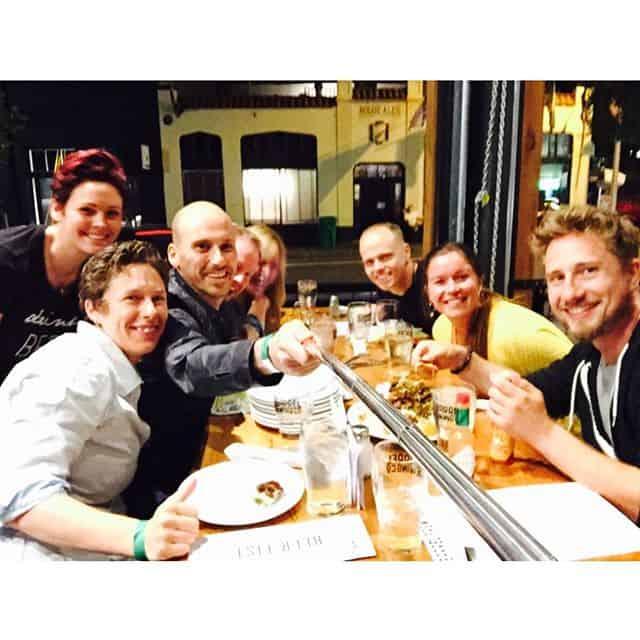 Group selfie with friends having dinner