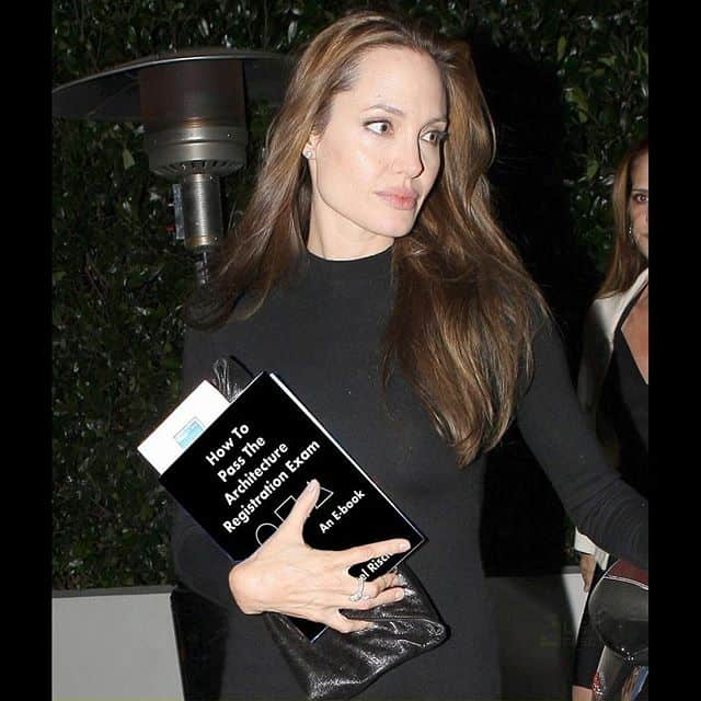 Angelina Jolie with Mike Riscica's book