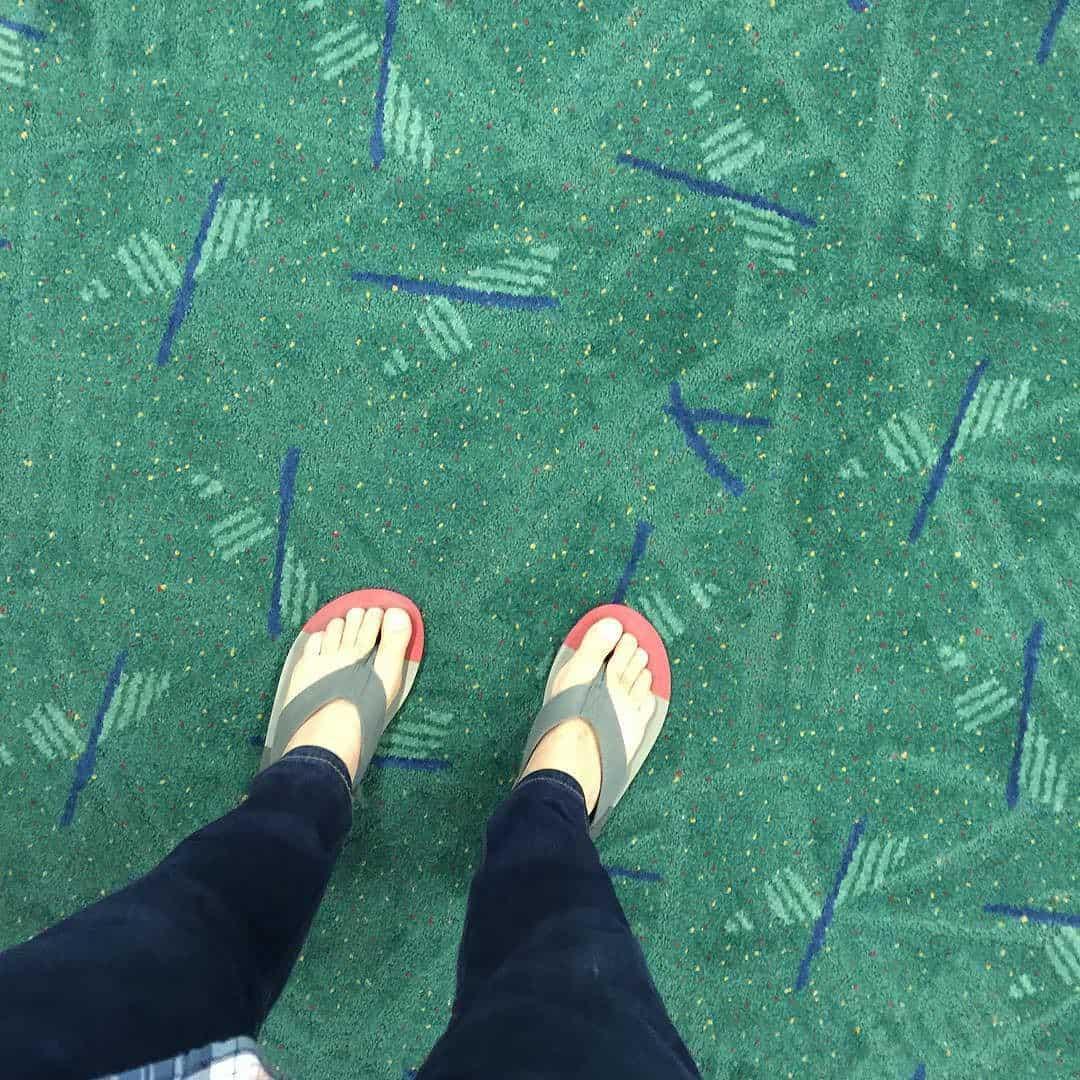 Flip flops on a carpet.