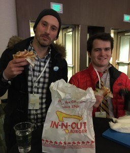 Eating Cheese Burger during Conference with a friend
