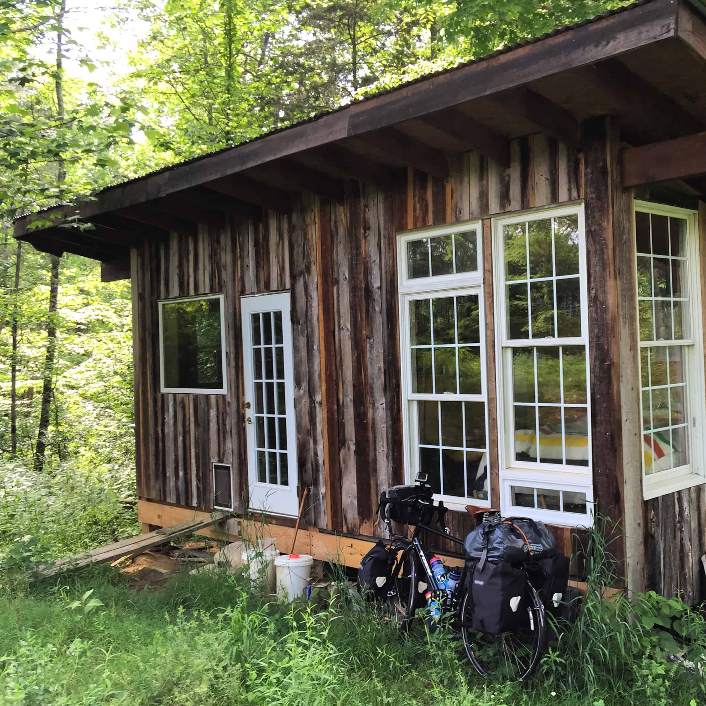 My super cute home for tonight. It was supposed to rain all day today. Which obviously didn't happen. Last night in a lame attempt to avoid camping in the rain, I reached out to another cross country cyclist who lives close to where I was going to end the day. She was out of town, but gave me directions to stay at her little cabin in the middle of the woods. I love it here! #biketouring #warmshowers #community #tinyhouse #offthegrid