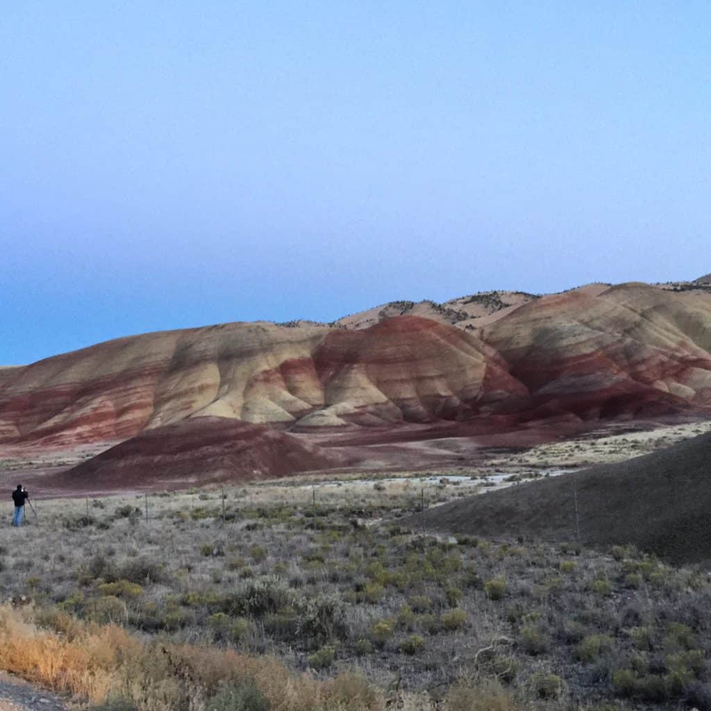 The painted hills with a scale figure. #Transam2016 #Biketouring #Bicycletour #CycleTouring #AdventureByBike #RideYourBike #GetOutAndRide #worldbybike #BikeTour #bikenation #bikewander #bikesofinstagram #Bikepacking #AdventureCycling #DudeRobot #acatransam