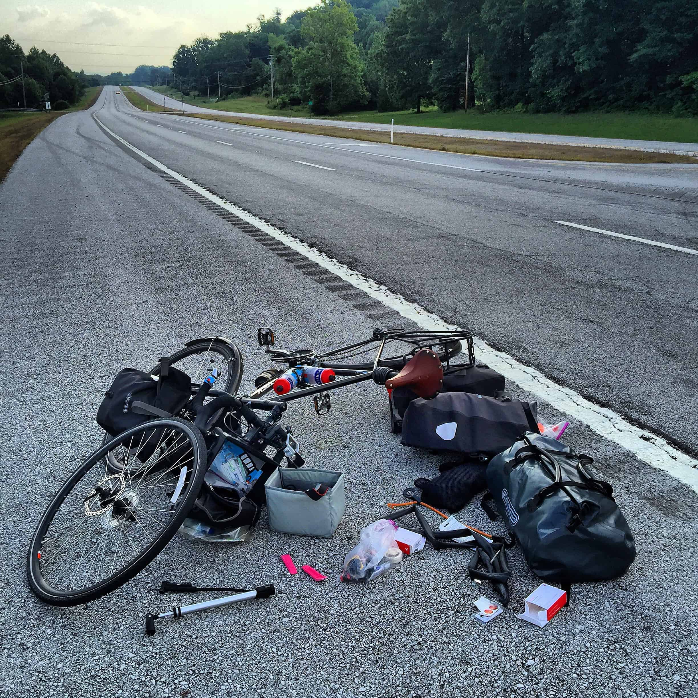 My first flat tire of my bike trip this summer. It was in Tennessee around mile 760 after I had ridden 7 miles in the completely wrong direction. Looks like a yard sale.