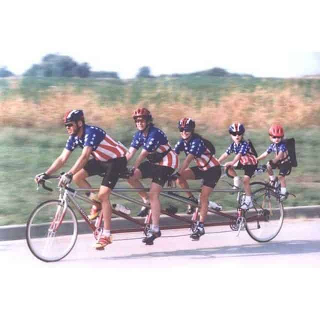 A cool family with matching clothes cycling