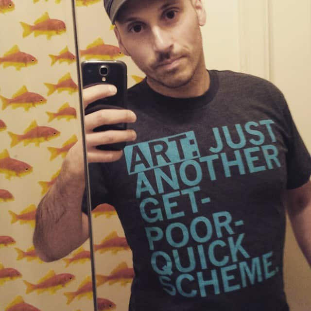 Mike Riscica mirros selfie in funny t-shirt about Art