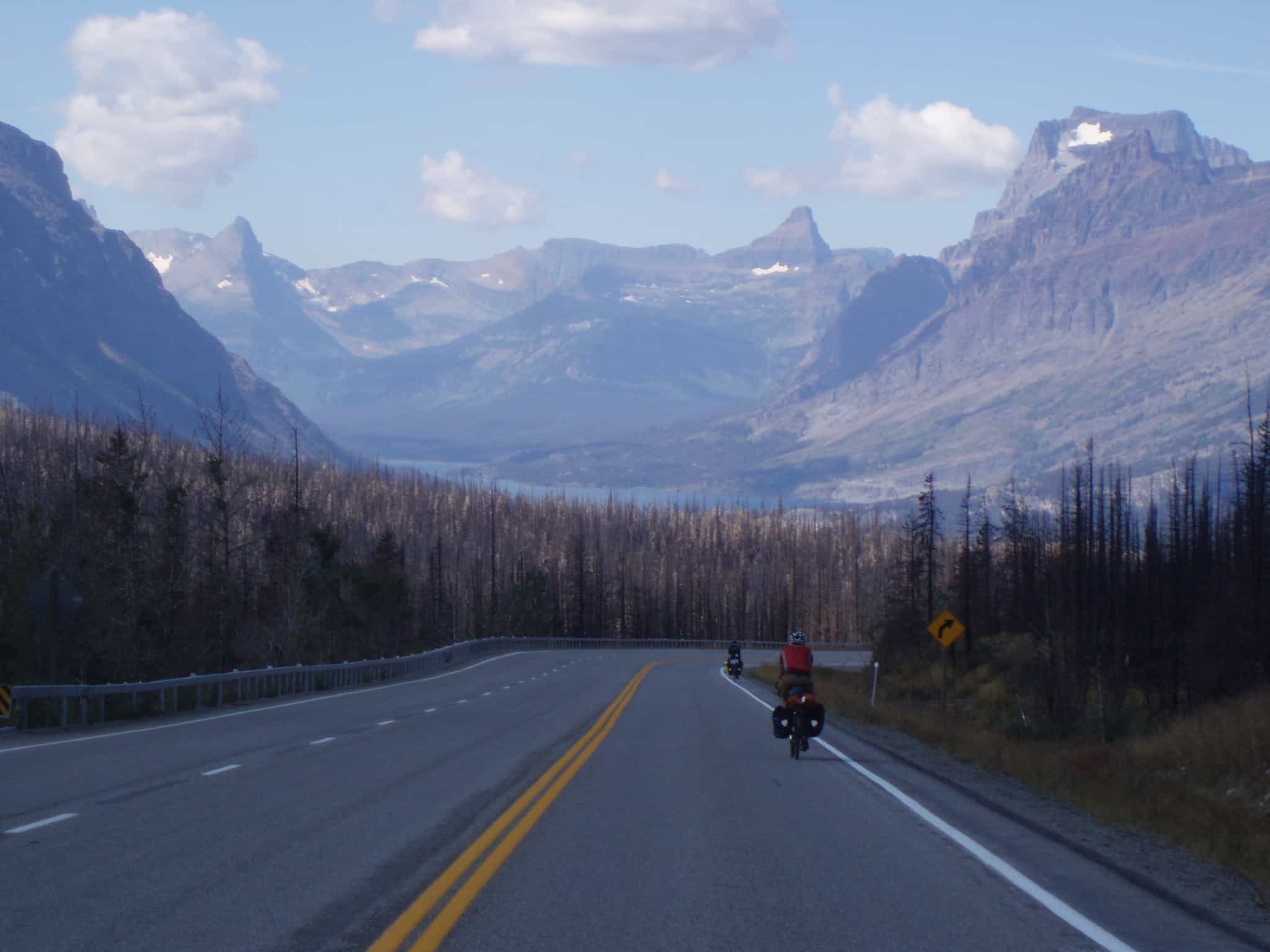 picture of michael Riscica riding bicycle into glacier park